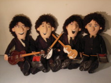 Beatles cloth dolls with their instruments