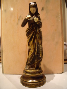 "An Albert-Ernst Carrier-Belleuse gilt bronze and ivory figure ""LISEUSE"""